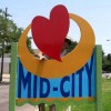 Hyper-Local Artist Refurbishes Mid-City Signs
